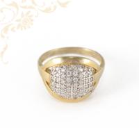 Rendkívül esztétikus, letisztult formájú, női köves arany gyűrű