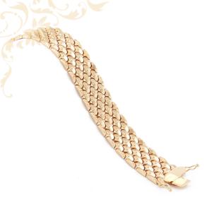 6 soros glídesnői arany karkötő. Rendkívül mutatós, feltűnő darab.