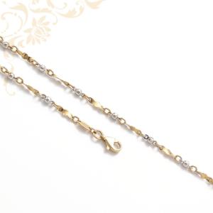 Nagyon elegáns női arany nyaklánc, ródium bevonattal díszítve.