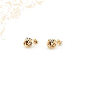 Csomót formázó (turbános) női üreges arany fülbevaló, gyémántvésett mintával és ródium bevonattal díszítve.