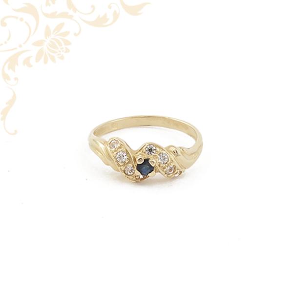 Kék színű szintetikus kővel díszített női arany gyűrű