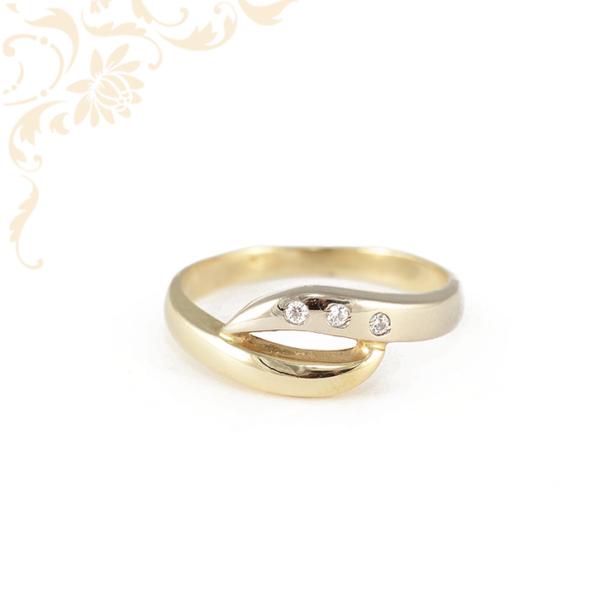 Hullámos vonalú, női köves arany gyűrű