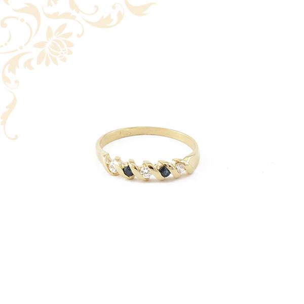 Sötétkék színű szintetikus és fehér színű cirkónia köves női arany gyűrű