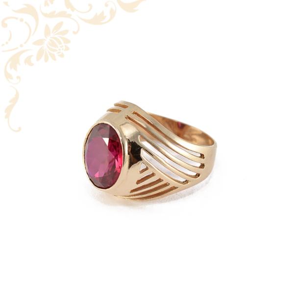 Klasszikus fazonú, női köves arany gyűrű piros színű szintetikus kővel díszítve