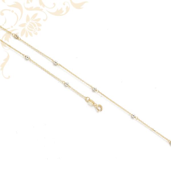 Női arany szemes nyaklánc, ródium bevonattal díszített aranygömbökkel díszítve.