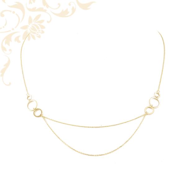 Kis súlyú, anker fazonú női arany nyaklánc, üreges karika díszítéssel.