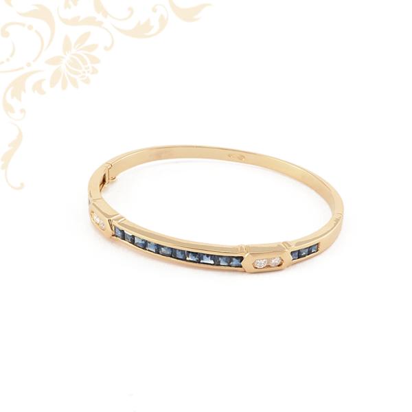 Nagyon elegáns, 18 karátos sárga arany reif karkötő gyémántokkal és zafírokkal ékesítve