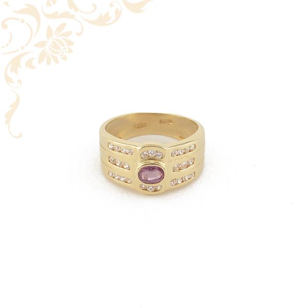 Bagyon szép és mutatós női arany gyűrű rózsaszín színű szintetikus kővel díszítve