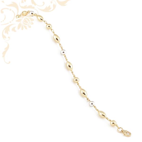 Nagyon elegáns és szép, női arany karkötő, ródium bevonatos arany gömböcskékkel, és zabszem formájú arany díszekkel ékesítve