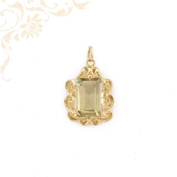 Női arany medál sárga színű kővel ékesítve.